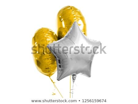 Három arany ezüst hélium léggömbök fehér Stock fotó © dolgachov