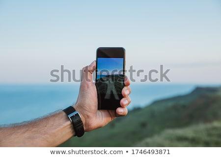 Kéz fotó lövöldözés üzenet felhő meztelen Stock fotó © ra2studio