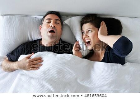 Ongelukkig vrouw lijden snurken slapen man Stockfoto © dolgachov