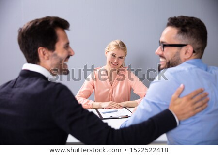 Two Happy Men At Adoption Agency Stock photo © AndreyPopov
