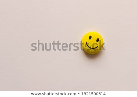 Funny yellow emoticon face copy space background Stock photo © cienpies