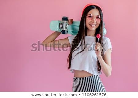 teenage girl in sunglasses with lollipop Stock photo © dolgachov