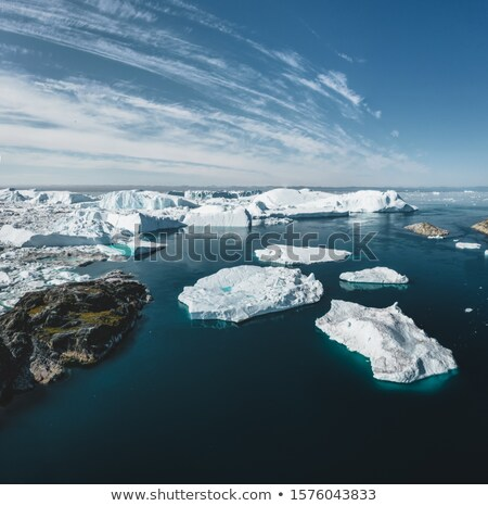 Global Warming and Climate Change - Icebergs from melting glacier in icefjord Stock photo © Maridav
