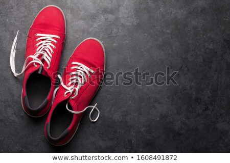 Pair of red sneakers over stone Stock photo © karandaev