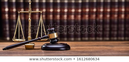 Gavel In Front Of Books With Golden Scale Stock photo © AndreyPopov