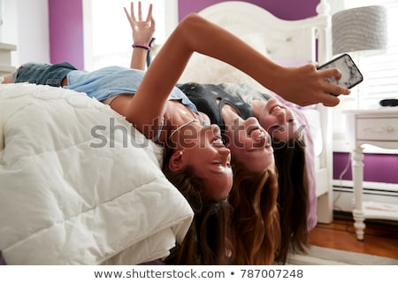 smiling red haired teenage girl using smartphone Stock photo © dolgachov