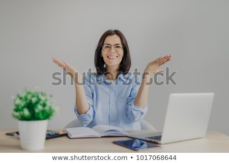 Happy overjoyed female achieves success in her work, going to present high results, raises hands joy Stock photo © vkstudio