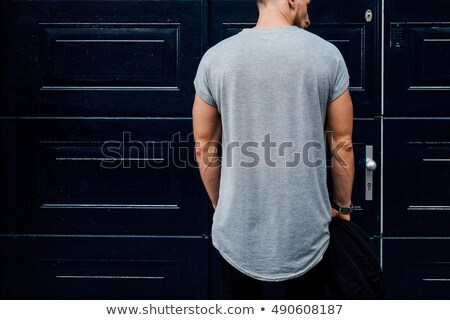 Man in blue t-shirt looking back at camera Stock photo © Giulio_Fornasar
