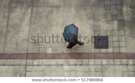 Paar paraplu mensen lopen onweersbui vrouw Stockfoto © robuart