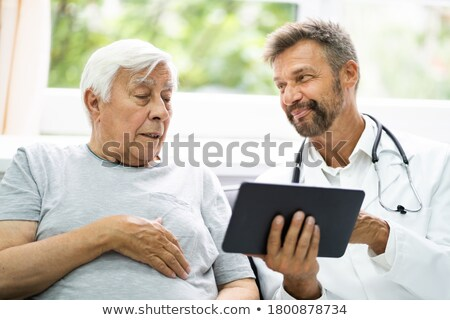 Home Care Elder Patient Looking At XRay Images Stock photo © AndreyPopov