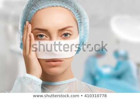 Plastic surgery female doctor look patient breast stock photo © CandyboxPhoto