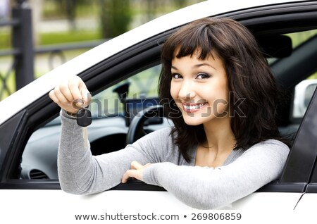 Pretty girl in a car Stock photo © Nobilior