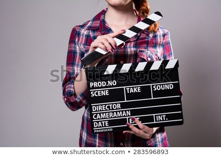 Girl in plaid shirt with movie camera Stock photo © RuslanOmega