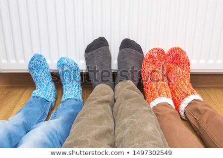 Láb radiátor fotó személyek csíkos zokni Stock fotó © RTimages