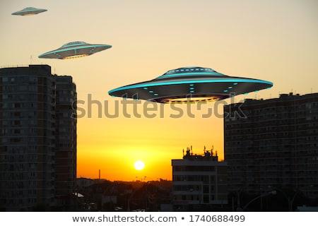 Ufo şehir üzerinde şehir merkezinde gökdelen karikatür Stok fotoğraf © blamb