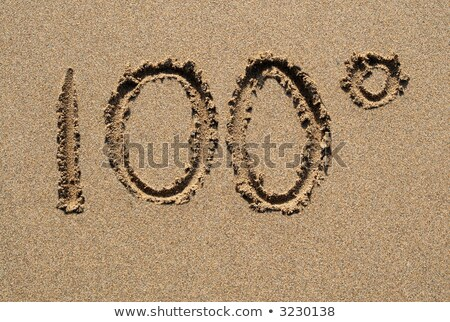 100 written on a sandy beach stock photo © latent
