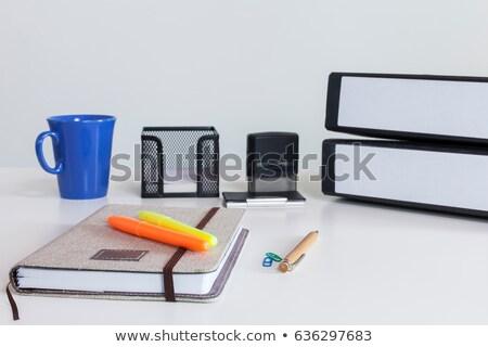 Notebook and ballpen on table. Stock photo © borysshevchuk