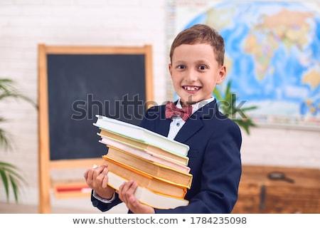Stock fotó: �ltalános · iskolás, · aki · nehéz · könyvhalmot · cipel