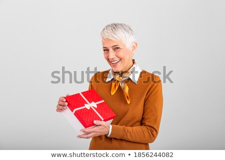 beautiful woman holding red ribbon with her finger stock photo © rob_stark