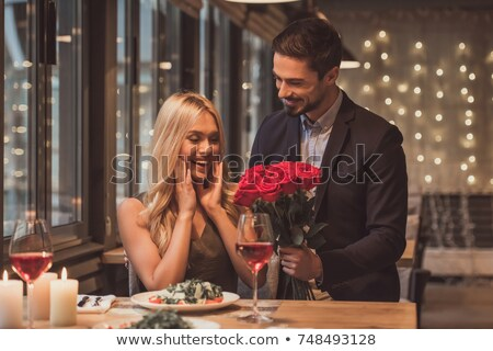 Couple with rose wine at a dinner party Stock photo © photography33
