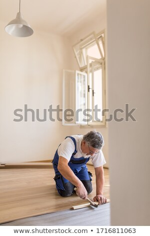 man sawing a wooden floor stock photo © photography33
