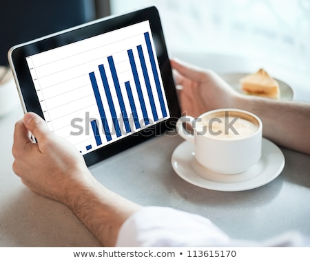 man holding tablet computer in cafe stock photo © dashapetrenko