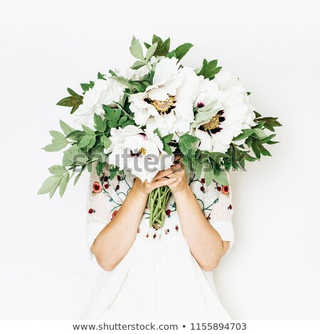 Young florist with bouquet and white card Stock photo © photography33