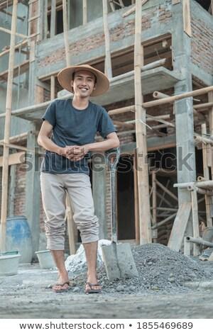 каменщик лопатой стороны здании человека Сток-фото © photography33