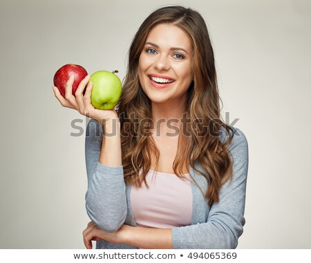 young woman holding a red and a green apple stock photo © photography33
