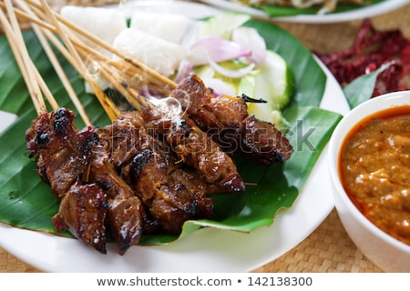 Chicken And Mutton Satay With Ketupat And Cucumbers Foto d'archivio © szefei