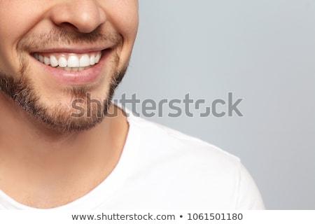 közelkép · mosolyog · férfi · portré · lezser · fiatalember - stock fotó © feedough