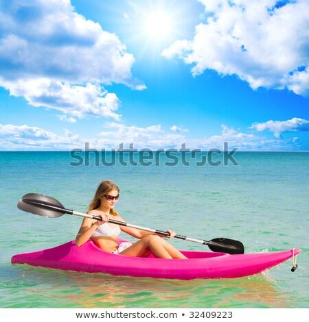 jovem · remo · barco · água · mulher · esportes - foto stock © photography33
