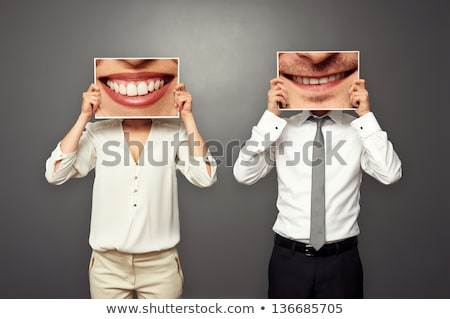 Male dentist holding picture of teeth Stock photo © photography33