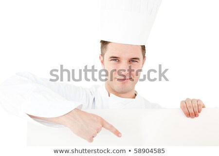 Self-assured caucasian male cook holding a placard showing on it against white background Stock photo © wavebreak_media