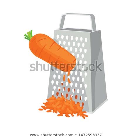 carrot on grater on white background stock photo © ozaiachin