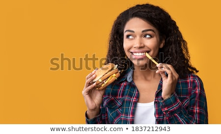 Woman eating burger and chips Stock photo © photography33