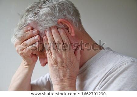 Worried man covering face Stock photo © stevanovicigor
