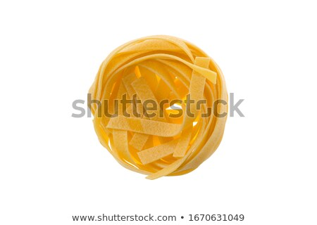 Close up dry tagliatelle on white background Stock photo © wavebreak_media