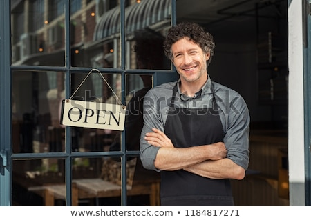 Waiter standing with open arms and smiling Stock photo © wavebreak_media