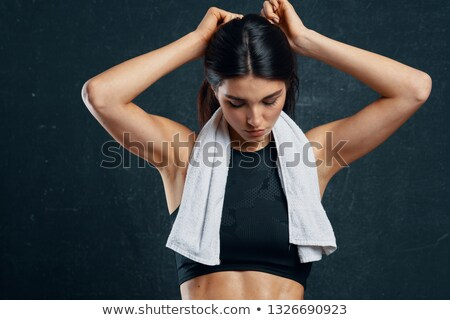 Sporty woman with towel around neck and water bottle stock photo © wavebreak_media