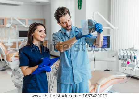 nurse with arms crossed and her team stock photo © wavebreak_media