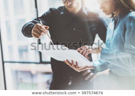 üzletember · megvizsgál · iratok · fiatal · felnőtt · bent · üzlet - stock fotó © 4designersart