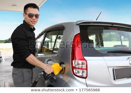 Férfi megtankol autó igazgató olaj állás Stock fotó © stockyimages