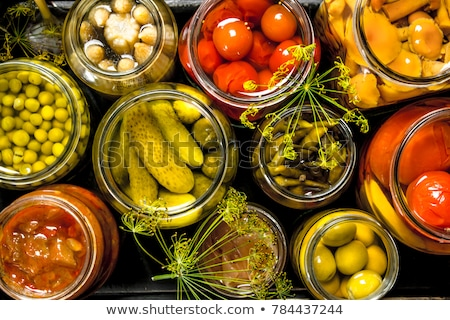 Stock photo: Pickled Vegetables And Fruit In Jars