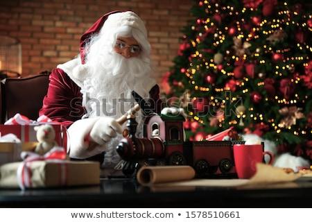 Santa Claus making toys Stock photo © HASLOO