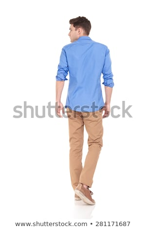 side view of a walking fashion man looking at his back Stock photo © feedough
