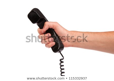 hand holding an old black telephone tube stock photo © bloodua