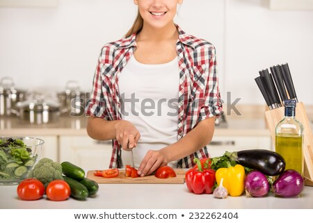 Young woman chopping vegetable for a salad Stock photo © julief514