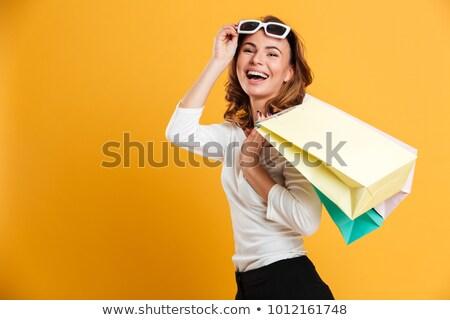Winkelen vrouw naar camera Stockfoto © HASLOO