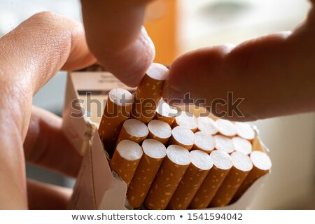 Man Hand Taking Cigarette  From Packet Stock photo © AndreyPopov